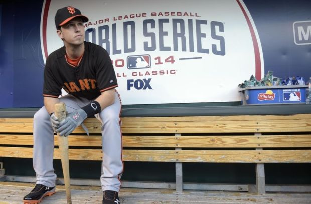 Oct 22, 2014; Kansas City, MO, USA; San Francisco Giants catcher Buster Posey sits in the dugout before game two of the 2014 World Series against the Kansas City Royals at Kauffman Stadium. Mandatory Credit: Christopher Hanewinckel-USA TODAY Sports