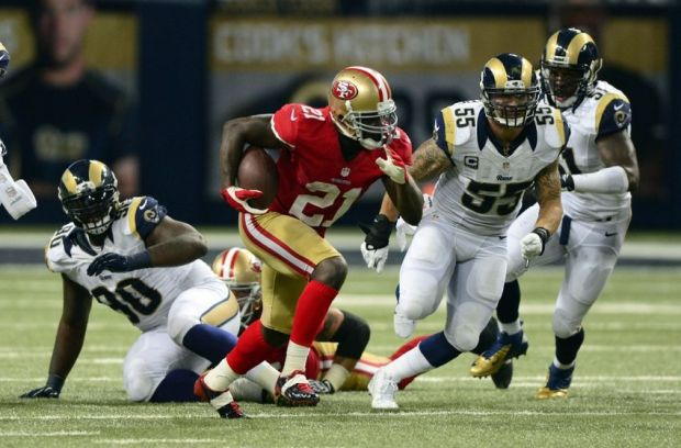 Sep 26, 2013; St. Louis, MO, USA; San Francisco 49ers running back Frank Gore (21) carries the ball as St. Louis Rams middle linebacker James Laurinaitis (55) gives chase during the second half at the Edward Jones Dome. San Francisco defeated St. Louis 35-11. Mandatory Credit: Jeff Curry-USA TODAY Sports