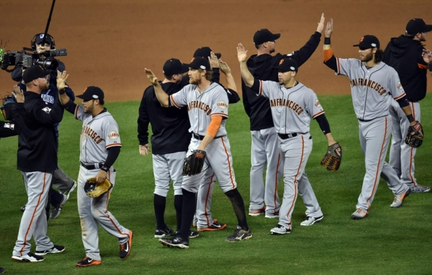 Oct 21, 2014; Kansas City, MO, USA; San Francisco Giants right fielder Hunter Pence (middle) celebrates with his teammates after defeating the Kansas City Royals during game one of the 2014 World Series at Kauffman Stadium. Mandatory Credit: Peter G. Aiken-USA TODAY Sports