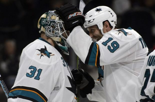 Oct 8, 2014; Los Angeles, CA, USA; San Jose Sharks goalie Antti Niemi (31) and center Joe Thornton (19) celebrate after the game against the Los Angeles Kings at Staples Center. The San Jose Sharks defeated the Los Angeles Kings 4-0. Mandatory Credit: Kelvin Kuo-USA TODAY Sports