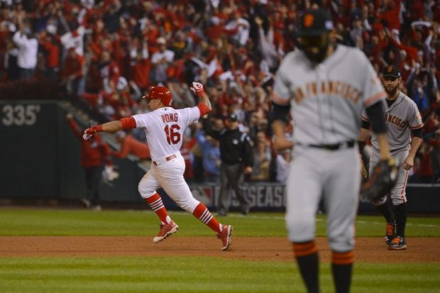 Oct 12, 2014; St. Louis, MO, USA; St. Louis Cardinals second baseman Kolten Wong (16) reacts after hitting the game-winning solo home run off of San Francisco Giants relief pitcher Sergio Romo (right) in the 9th inning in game two of the 2014 NLCS playoff baseball game at Busch Stadium. Mandatory Credit: Jeff Curry-USA TODAY Sports
