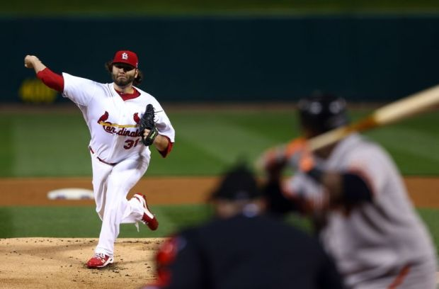 Oct 19, 2012; St. Louis, MO, USA; St. Louis Cardinals starting pitcher Lance Lynn (31) throws against the San Francisco Giants during the first inning of game five of the 2012 NLCS at Busch Stadium.  Mandatory Credit: Elsa/Pool Photo via USA TODAY Sports