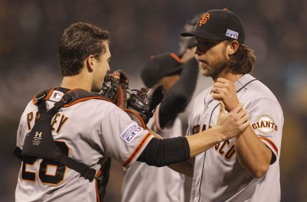 Oct 1, 2014; Pittsburgh, PA, USA; San Francisco Giants starting pitcher Madison Bumgarner (40) celebrates with catcher Buster Posey (28) after defeating the Pittsburgh Pirates in the 2014 National League Wild Card playoff baseball game at PNC Park. The Giants won 8-0. Mandatory Credit: Charles LeClaire-USA TODAY Sports