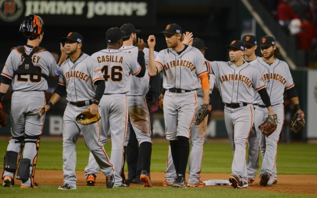 Oct 11, 2014; St. Louis, MO, USA; San Francisco Giants players celebrate on the field after defeating the St. Louis Cardinals in game one of the 2014 NLCS playoff baseball game at Busch Stadium. Mandatory Credit: Jeff Curry-USA TODAY Sports