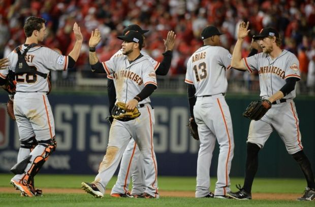 Oct 3, 2014; Washington, DC, USA; San Francisco Giants players celebrate their 3-2 win in game one of the 2014 NLDS playoff baseball game against the Washington Nationals at Nationals Park. Mandatory Credit: H.Darr Beiser-USA TODAY Sports