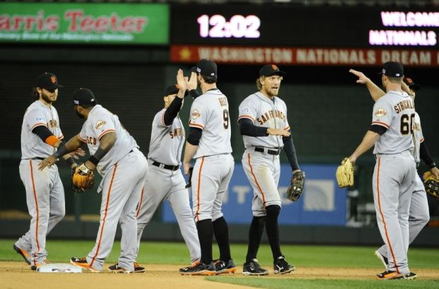 Oct 4, 2014; Washington, DC, USA; San Francisco Giants celebrate after winning 2-1 against the Washington Nationals in 18 innings in game two of the 2014 NLDS playoff baseball game at Nationals Park. Mandatory Credit: Brad Mills-USA TODAY Sports