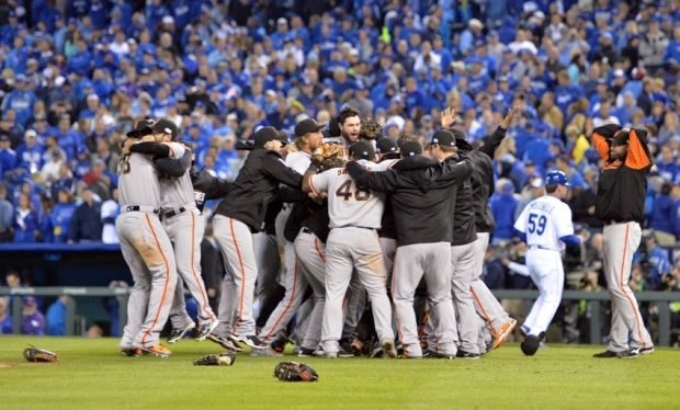 Oct 29, 2014; Kansas City, MO, USA; San Francisco Giants players celebrate on the field after defeating the Kansas City Royals in game seven of the 2014 World Series at Kauffman Stadium. Mandatory Credit: Peter G. Aiken-USA TODAY Sports