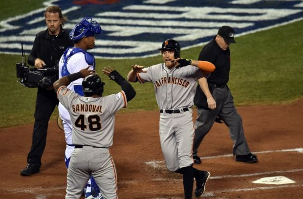 Oct 21, 2014; Kansas City, MO, USA; San Francisco Giants right fielder Hunter Pence (right) celebrates with third baseman Pablo Sandoval (48) after hitting a two-run home run against the Kansas City Royals in the first inning during game one of the 2014 World Series at Kauffman Stadium. Mandatory Credit: Peter G. Aiken-USA TODAY Sports