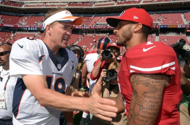 Aug 17, 2014; Santa Clara, CA, USA; Denver Broncos quarterback Peyton Manning (18) and San Francisco 49ers quarterback Colin Kaepernick (7) shake hands after the inaugural football game at Levi's Stadium. The Broncos defeated the 49ers 34-0. Mandatory Credit: Kirby Lee-USA TODAY Sports