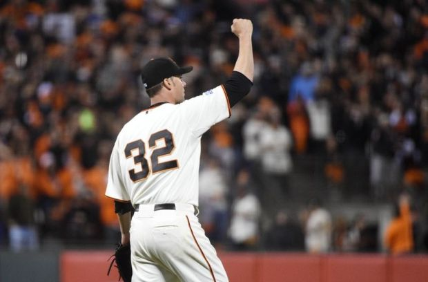 Oct 7, 2014; San Francisco, CA, USA; San Francisco Giants starting pitcher Ryan Vogelsong reacts after a catch by right fielder Hunter Pence (not pictured) in the sixth inning during game four of the 2014 NLDS baseball playoff game against the Washington Nationals at AT&T Park. Mandatory Credit: Kyle Terada-USA TODAY Sports