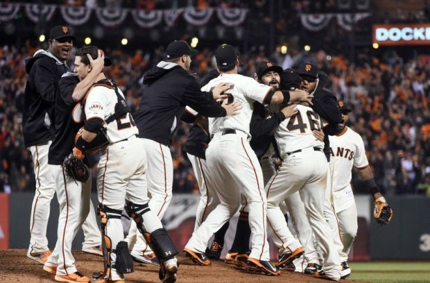 Oct 7, 2014; San Francisco, CA, USA; San Francisco Giants players celebrate on the field with relief pitcher Santiago Casilla (46) after defeating the Washington Nationals in game four of the 2014 NLDS baseball playoff game at AT&T Park. The Giants won the series three games to one and advance to the NLCS. Mandatory Credit: Kyle Terada-USA TODAY Sports