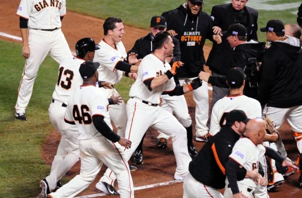 Oct 16, 2014; San Francisco, CA, USA; San Francisco Giants left fielder Travis Ishikawa (45) celebrates with teammates as he tries to get to home plate after hitting a walk off three run home run against the St. Louis Cardinals during the ninth inning of game five of the 2014 NLCS playoff at AT&T Park. Giants won 6-3. Mandatory Credit: Ed Szczepanski-USA TODAY Sports