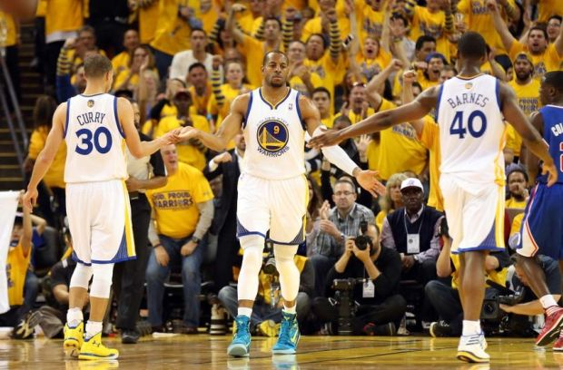 Apr 24, 2014; Oakland, CA, USA; Golden State Warriors forward Andre Iguodala (9) high fives guard Stephen Curry (30) and forward Harrison Barnes (40) after a basket against the Los Angeles Clippers during the third quarter of game three of the first round of the 2014 NBA Playoffs at Oracle Arena. The Los Angeles Clippers defeated the Golden State Warriors 98-96. Mandatory Credit: Kelley L Cox-USA TODAY Sports