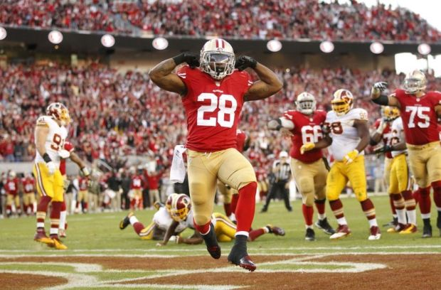 Nov 23, 2014; Santa Clara, CA, USA; San Francisco 49ers running back Carlos Hyde (28) reacts after scoring a touchdown against the Washington Redskins in the fourth quarter at Levi's Stadium. The 49ers defeated the Redskins 17-13. Mandatory Credit: Cary Edmondson-USA TODAY Sports