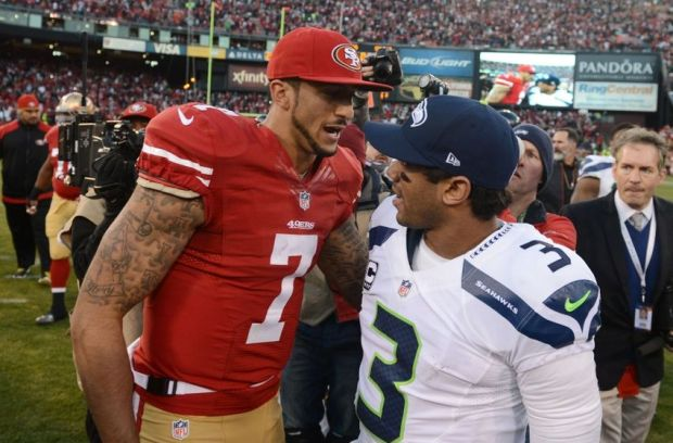 December 8, 2013; San Francisco, CA, USA; San Francisco 49ers quarterback Colin Kaepernick (7) shakes hands with Seattle Seahawks quarterback Russell Wilson (3) after the game at Candlestick Park. The 49ers defeated the Seahawks 19-17. Mandatory Credit: Kyle Terada-USA TODAY Sports
