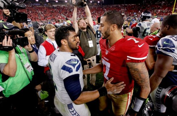 Nov 27, 2014; Santa Clara, CA, USA; San Francisco 49ers quarterback Colin Kaepernick (7) meets with Seattle Seahawks quarterback Russell Wilson (3) after the game at Levi's Stadium. The Seahawks defeated the 49ers 19-3. Mandatory Credit: Cary Edmondson-USA TODAY Sports