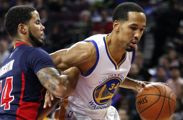 Nov 30, 2014; Auburn Hills, MI, USA; Golden State Warriors guard Shaun Livingston (34) defended by Detroit Pistons guard D.J. Augustin (14) during the second quarter at The Palace of Auburn Hills. Mandatory Credit: Raj Mehta-USA TODAY Sports
