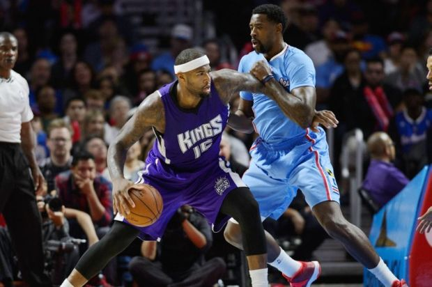 Nov 2, 2014; Los Angeles, CA, USA; Sacramento Kings center DeMarcus Cousins (15) attempts to move the ball defended by Los Angeles Clippers center DeAndre Jordan (6) during the fourth quarter at Staples Center. The Sacramento Kings defeated the Los Angeles Clippers 98-92. Mandatory Credit: Kelvin Kuo-USA TODAY Sports