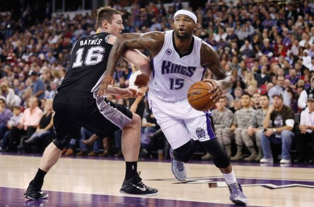 Nov 15, 2014; Sacramento, CA, USA; Sacramento Kings center DeMarcus Cousins (15) drives against San Antonio Spurs forward Aron Baynes (16) during the first quarter at Sleep Train Arena. Mandatory Credit: Kelley L Cox-USA TODAY Sports