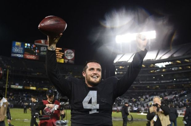 November 20, 2014; Oakland, CA, USA; Oakland Raiders quarterback Derek Carr (4) celebrates after the game against the Kansas City Chiefs at O.co Coliseum. The Raiders defeated the Chiefs 24-20. Mandatory Credit: Kyle Terada-USA TODAY Sports