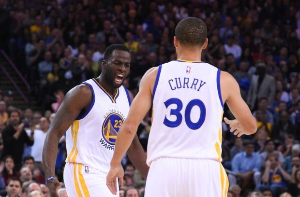 November 5, 2014; Oakland, CA, USA; Golden State Warriors forward Draymond Green (23) celebrates with guard Stephen Curry (30) against the Los Angeles Clippers during the second quarter at Oracle Arena. Mandatory Credit: Kyle Terada-USA TODAY Sports
