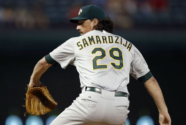 Sep 27, 2014; Arlington, TX, USA; Oakland Athletics starting pitcher Jeff Samardzija (29) delivers to the Texas Rangers during a baseball game at Globe Life Park in Arlington. Mandatory Credit: Jim Cowsert-USA TODAY Sports