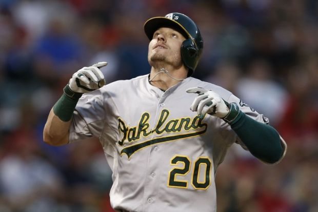 Sep 27, 2014; Arlington, TX, USA; Oakland Athletics third baseman Josh Donaldson (20) reacts as he crosses home plate following his solo home run against the Texas Rangers during a baseball game at Globe Life Park in Arlington. Mandatory Credit: Jim Cowsert-USA TODAY Sports