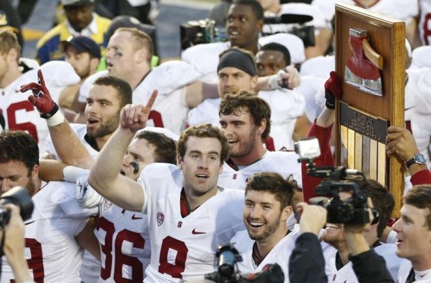 Nov 22, 2014; Berkeley, CA, USA; Stanford Cardinal quarterback Kevin Hogan (8) holds up a number one sign in front of the Stanford Axe after game against the California Golden Bears at Memorial Stadium. Mandatory Credit: Bob Stanton-USA TODAY Sports