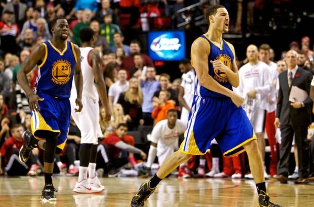 Nov 2, 2014; Portland, OR, USA; Golden State Warriors guard Klay Thompson (11) reacts after making the game winning shot against the Portland Trail Blazers during the fourth quarter at the Moda Center. Mandatory Credit: Craig Mitchelldyer-USA TODAY Sports