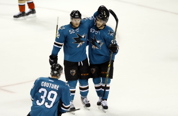 Nov 29, 2014; San Jose, CA, USA; San Jose Sharks defenseman Matt Irwin (52) congratulates left wing Matt Nieto (83) who scored an empty-net goal against the Anaheim Ducks at SAP Center at San Jose. Sharks won 6 to 4. Mandatory Credit: Bob Stanton-USA TODAY Sports