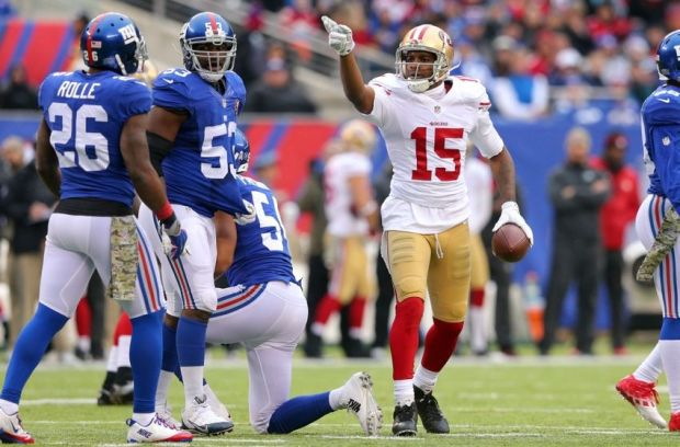 Nov 16, 2014; East Rutherford, NJ, USA; San Francisco 49ers wide receiver Michael Crabtree (15) signals first down against the New York Giants during the second quarter at MetLife Stadium. Mandatory Credit: Brad Penner-USA TODAY Sports
