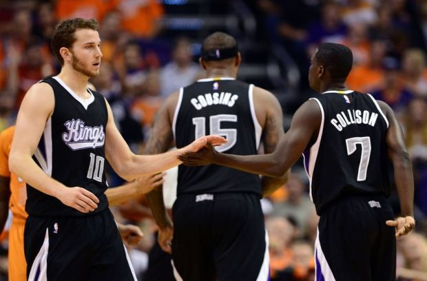 Nov 7, 2014; Phoenix, AZ, USA; Sacramento Kings guard Nik Stauskas (10) and guard Darren Collison (7) high five in the second half while playing against the Phoenix Suns at US Airways Center. The Kings won 114-112 in double overtime. Mandatory Credit: Jennifer Stewart-USA TODAY Sports