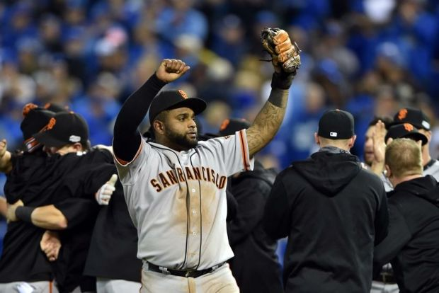 Oct 29, 2014; Kansas City, MO, USA; San Francisco Giants third baseman Pablo Sandoval celebrates after defeating the Kansas City Royals during game seven of the 2014 World Series at Kauffman Stadium. Mandatory Credit: Peter G. Aiken-USA TODAY Sports
