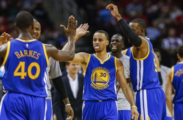 Nov 8, 2014; Houston, TX, USA; Golden State Warriors guard Stephen Curry (30) celebrates with teammates after a play during the third quarter against the Houston Rockets at Toyota Center. Mandatory Credit: Troy Taormina-USA TODAY Sports