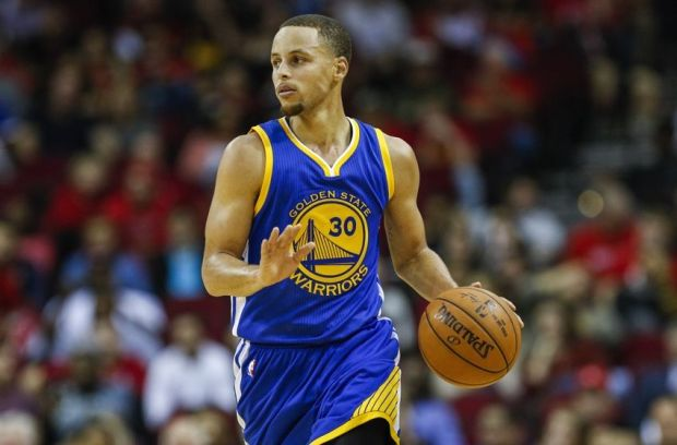 Nov 8, 2014; Houston, TX, USA; Golden State Warriors guard Stephen Curry (30) brings the ball up the court during the fourth quarter against the Houston Rockets at Toyota Center. The Warriors defeated the Rockets 98-87. Mandatory Credit: Troy Taormina-USA TODAY Sports