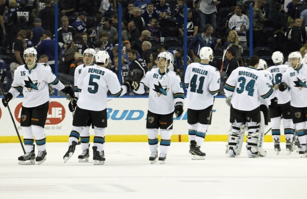 Nov 13, 2014; Tampa, FL, USA; San Jose Sharks center Tyler Kennedy (81) and teammates congratulate each other after they beat the Tampa Bay Lightning during the third period at Amalie Arena. San Jose Sharks defeated the Tampa Bay Lightning 2-1. Mandatory Credit: Kim Klement-USA TODAY Sports