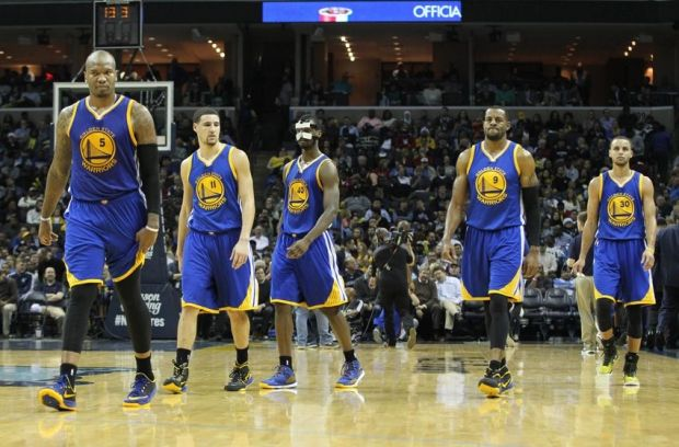 Dec 16, 2014; Memphis, TN, USA; Golden State Warriors forward Marries Speights (5) guard Klay Thompson (11) forward Harrison Barnes (40) and guards Andre Iguodala (9) and Stephen Curry (30) walk back on the court after a timeout in the first half against the Memphis Grizzlies at FedExForum. Mandatory Credit: Nelson Chenault-USA TODAY Sports