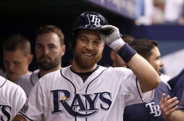 Jul 29, 2014; St. Petersburg, FL, USA; Tampa Bay Rays second baseman Ben Zobrist (18) smiles in the dugout after he hit a solo home run during the sixth inning against the Milwaukee Brewers at Tropicana Field. Mandatory Credit: Kim Klement-USA TODAY Sports