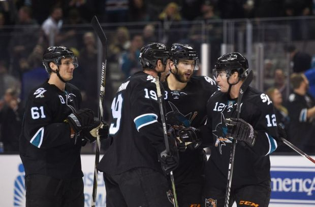 December 11, 2014; San Jose, CA, USA; San Jose Sharks defenseman Brent Burns (88) is congratulated for scoring a goal against the Minnesota Wild during the second period at SAP Center at San Jose. Mandatory Credit: Kyle Terada-USA TODAY Sports