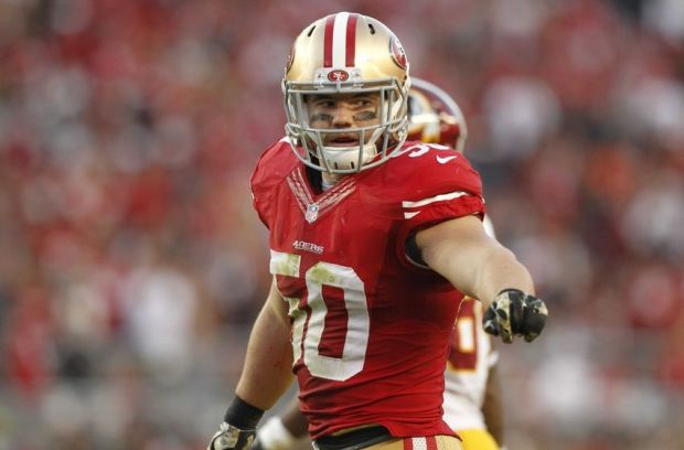 Nov 23, 2014; Santa Clara, CA, USA; San Francisco 49ers inside linebacker Chris Borland (50) stands on the field against the Washington Redskins in the fourth quarter at Levi's Stadium. The 49ers defeated the Redskins 17-13. Mandatory Credit: Cary Edmondson-USA TODAY Sports
