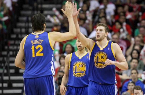 Mar 17, 2013; Houston, TX, USA; Golden State Warriors power forward David Lee (10) is congratulated by Andrew Bogut (12) during the fourth quarter against the Houston Rockets at Toyota Center. Mandatory Credit: Troy Taormina-USA TODAY Sports
