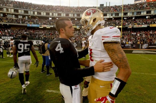 Dec 7, 2014; Oakland, CA, USA; Oakland Raiders quarterback Derek Carr (4) talks with San Francisco 49ers quarterback Colin Kaepernick (7) after the game at O.co Coliseum. The Raiders defeated the 49ers 24-13. Mandatory Credit: Cary Edmondson-USA TODAY Sports