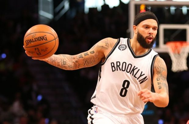 Dec 12, 2014; Brooklyn, NY, USA;  Brooklyn Nets guard Deron Williams (8) moves the ball during the third quarter against the Philadelphia 76ers at Barclays Center. Brooklyn Nets won 88-70. Mandatory Credit: Anthony Gruppuso-USA TODAY Sports