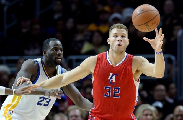 Dec 25, 2014; Los Angeles, CA, USA; Golden State Warriors forward Draymond Green (23) guards Los Angeles Clippers forward Blake Griffin (32) in the first half at Staples Center. Mandatory Credit: Jayne Kamin-Oncea-USA TODAY Sports