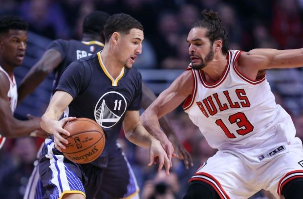 Dec 6, 2014; Chicago, IL, USA; Golden State Warriors guard Klay Thompson (11) drives on Chicago Bulls center Joakim Noah (13) during the first quarter at the United Center. Mandatory Credit: Dennis Wierzbicki-USA TODAY Sports
