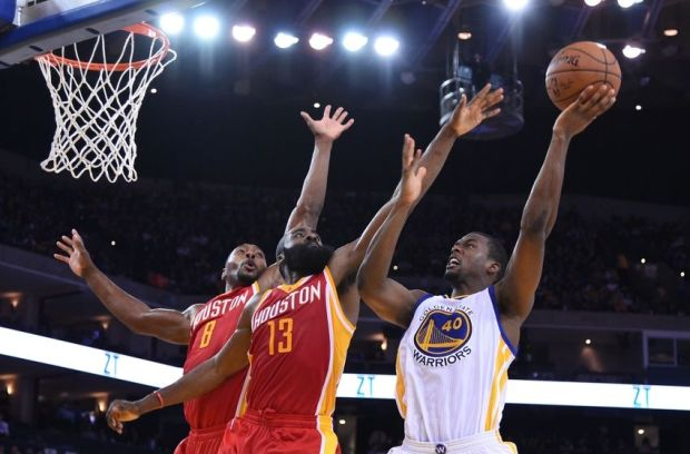 December 10, 2014; Oakland, CA, USA; Golden State Warriors forward Harrison Barnes (40) shoots the basketball against Houston Rockets guard James Harden (13) and forward Joey Dorsey (8) during the third quarter at Oracle Arena. The Warriors defeated the Rockets 105-93. Mandatory Credit: Kyle Terada-USA TODAY Sports