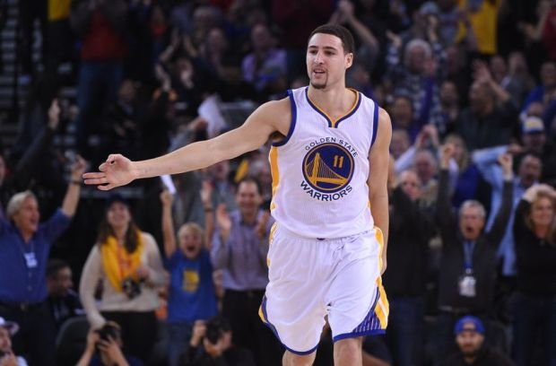 December 18, 2014; Oakland, CA, USA; Golden State Warriors guard Klay Thompson (11) celebrates after a three-point basket during the second quarter against the Oklahoma City Thunder at Oracle Arena. The Warriors defeated the Thunder 114-109. Mandatory Credit: Kyle Terada-USA TODAY Sports