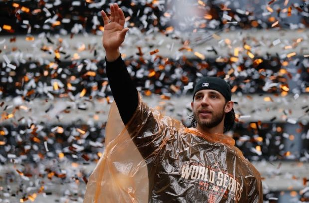 Oct 31, 2014; San Francisco, CA, USA; San Francisco Giants starting pitcher Madison Bumgarner waves to the crowd during the World Series victory parade on Market Street. Mandatory Credit: Kelley L Cox-USA TODAY Sports