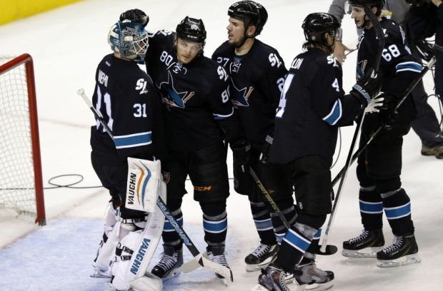 Dec 18, 2014; San Jose, CA, USA; San Jose Sharks defenseman Matt Tennyson (80) congratulates Sharks goalie Antti Niemi (31) after the game against the Edmonton Oilers at SAP Center at San Jose. San Jose won 4-3. Mandatory Credit: Bob Stanton-USA TODAY Sports