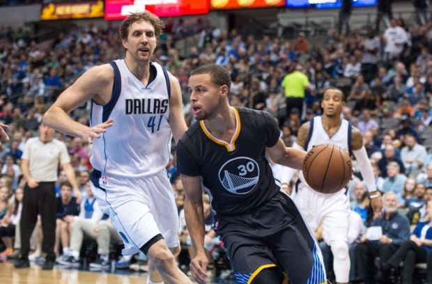 Dec 13, 2014; Dallas, TX, USA; Golden State Warriors guard Stephen Curry (30) dribbles the ball past Dallas Mavericks forward Dirk Nowitzki (41) during the second half at the American Airlines Center. The Warriors defeated the Mavericks 105-98. Mandatory Credit: Jerome Miron-USA TODAY Sports